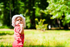 Ponderer child. The child to think putting a finger in her mouth Stock Photos