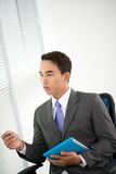 Pondering businessman Stock Image