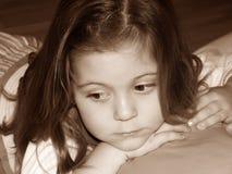 Pondering da menina Foto de Stock