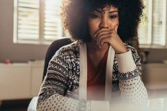 Pondering female designer thinking on creative ideas Stock Images