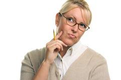 Pondering a mulher bonita com lápis Imagem de Stock Royalty Free