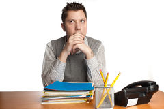 Pondering office worker Royalty Free Stock Photography
