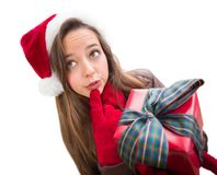 Pondering Teenager Wearing A Christmas Santa Hat with Bow Wrapped Gif Royalty Free Stock Image