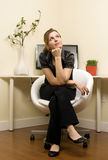 Pondering young Woman in Home Office Royalty Free Stock Photo