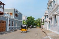 Auto rickshaw on the street in Pondicherry, India. Pondicherry, Puducherry, India - October 12, 2014: Auto rickshaw or tuk-tuk on the street in Pondicherry Royalty Free Stock Image
