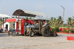 The blue tractor filling up petrol at the local petrol station in India stock image