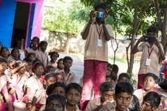 Documentary editorial image. Meeting at the government school. PONDICHERY, PUDUCHERY, INDIA - SEPTEMBER 04, 2017. Outdoor meeting of the children of the school Stock Photo