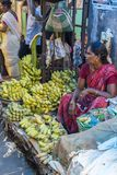 Documentary editorial image. An unidentified Indian at his fruit and vegetable shop in a small rural village market in Tamil Nadu. Stock Photo