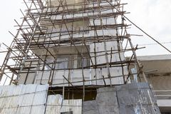 Documentary editorial image. An unidentified man works at heights. Very insecure scaffoldings Royalty Free Stock Photos