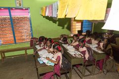 Documentary editorial image. Unidentified school children study in classroom at government public school. Stock Images