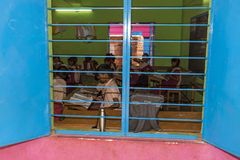 Documentary editorial image. Unidentified school children study in classroom at government public school. Stock Image