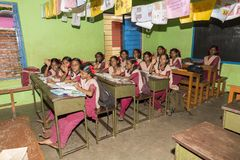 Documentary editorial image. Unidentified school children study in classroom at government public school. Stock Photos