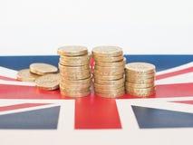 Pondmuntstukken, het Verenigd Koninkrijk over vlag Royalty-vrije Stock Fotografie