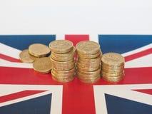 Pondmuntstukken, het Verenigd Koninkrijk over vlag Stock Afbeelding