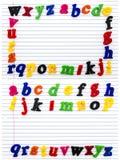 Pone letras al espacio de la copia de papel del cuaderno del alfabeto Fotografía de archivo