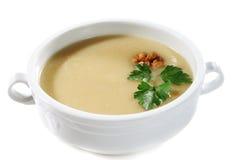 _poner crema sopa Foto de archivo