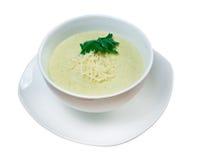 _poner crema sopa con calabacín Imágenes de archivo libres de regalías