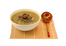 _ poner crema sopa con seta Foto de archivo