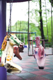 Poneys on playground. Poneys in a carousel in children's playground Royalty Free Stock Image