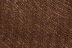 Ponga en contraste el fondo de la materia textil en tonalidad marr?n eficaz imágenes de archivo libres de regalías