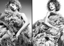 Ponga en contraste la imagen blanco y negro de la mujer joven hermosa en un vestido voluminoso fotografía de archivo libre de regalías
