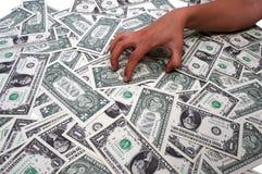 Ponga la mano en su dinero Imagenes de archivo