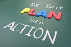 Ponga su plan en la acción Imagen de archivo