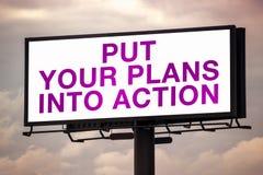Ponga sus planes en la acción en la cartelera al aire libre de Advertsing Imagen de archivo libre de regalías