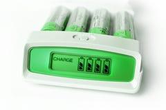 Ponga verde el cargador de batería Fotografía de archivo libre de regalías