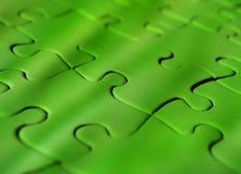Ponga verde el rompecabezas de rompecabezas Fotografía de archivo