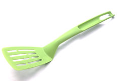 Ponga verde la espátula de la cocina Imagen de archivo libre de regalías