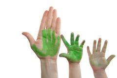 Ponga verde a la madre de la pintura, hijo, mano de la hija Imagen de archivo