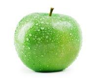 Ponga verde la manzana con gotas del agua Fotos de archivo