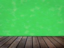 Ponga verde la pared de ladrillo Foto de archivo