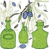 Ponga verde las botellas con las aceitunas Imágenes de archivo libres de regalías