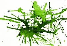 Ponga verde las salpicaduras de la tinta Fotografía de archivo