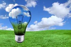 Ponga verde las soluciones de la energía con la bombilla internacional Morphed Fotografía de archivo libre de regalías