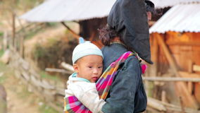 PONGSALI, LAOS - APRIL 2014: native Akha woman carry baby stock video footage