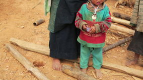 PONGSALI, LAOS - APRIL 2014: native Akha woman carry baby stock video