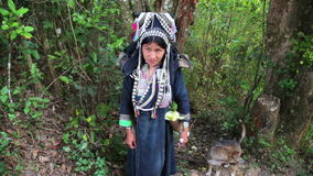 PONGSALI, LAOS - APRIL 2014: native Akha woman carry water stock footage