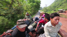 PONGSALI,LAOS - APRIL 2014: passenger journey roof top of bus stock video