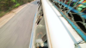 PONGSALI,LAOS - APRIL 2014: passenger journey roof top of bus stock footage