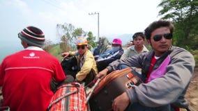 PONGSALI,LAOS - APRIL 2014: passenger journey roof top of bus stock video footage