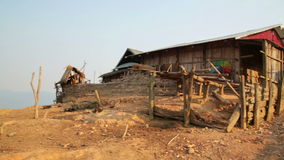 PONGSALI, LAOS - APRIL 2014: tribal Akha village stock footage