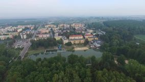 Poniatowa, small city, aerial view. Poniatowa, aerial view, lubelskie, nature, small city, green city, large forest areas stock video footage