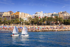 Poniente beach in Benidorm with two boats sailing to the bay Royalty Free Stock Photos