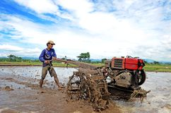 Ponorogo. INDONESIA - APRIL 13, 2014: Farmer plowing his field with a tractor in Gontor Village, , East Java, Indonesia. Photo taken on: April 13st, 2014 royalty free stock images