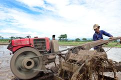 Ponorogo. INDONESIA - APRIL 13, 2014: Farmer plowing his field with a tractor in Gontor Village, , East Java, Indonesia Stock Image