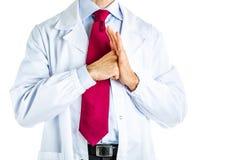 Ponsen een palmgebaar door arts in witte laag Stock Fotografie