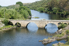 Ponsul river, old bridge in Beira Baixa, Portugal. View of Ponsul river and the old bridge over in the road between Castelo Branco and Monforte da Beira and Royalty Free Stock Photography